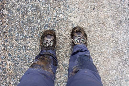 legs and feet, very wet and clarted in mud after falling into a boggy area