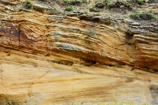 Layers in golden sandstone - the layers run in different directions
