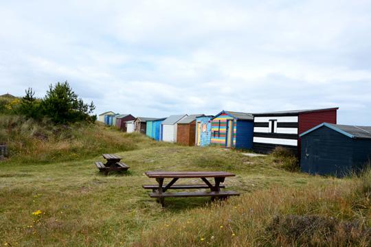 Colourful beach huts at Hopeman beach
