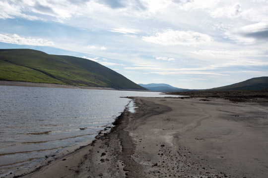 At the edge of the road, where it starts to disappear into the loch, looking eastwards