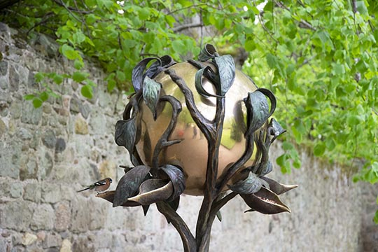 Architectural feature which is a bird feeder - complete with male chaffinch