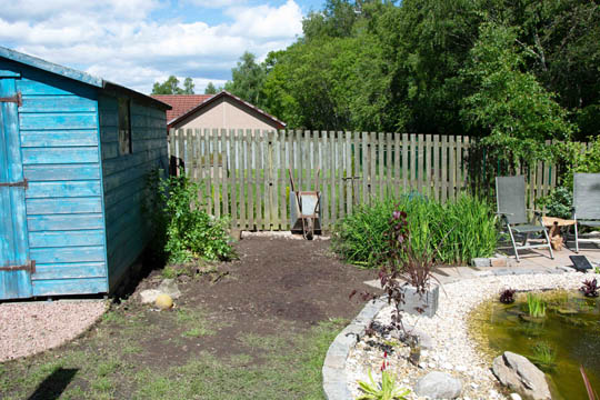 area cleared for the wildflowers and bulky tool storage area
