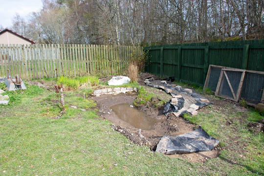 Drainage ditch now complete with pea gravel over the drainage pipe