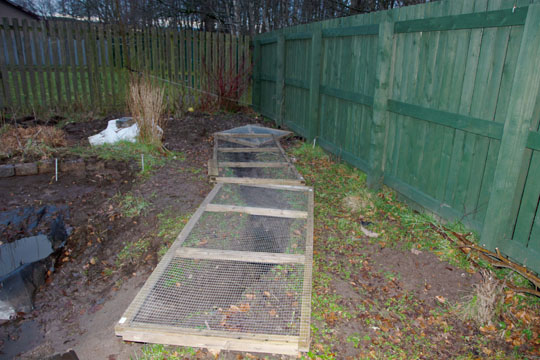 Drainage ditch covered in wood and wire panels