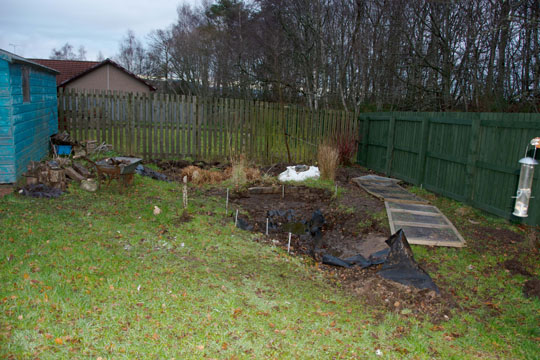 New pond marked out and drainage ditch covered over with netting panels