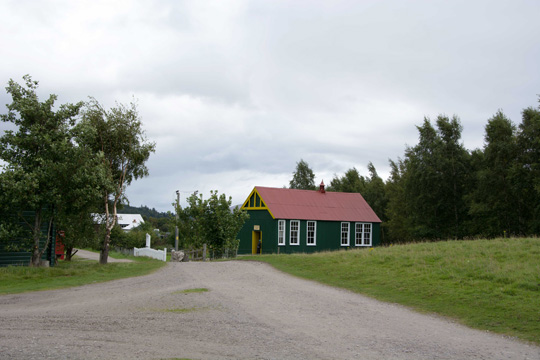 Green building with a red roof, which was Knockbain school