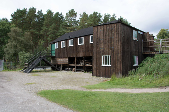 large wooden 2 storey building which is the woodworkers shed