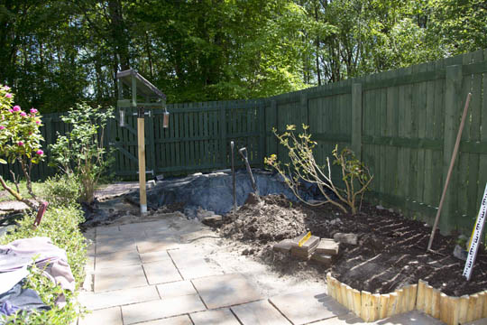 Newly slabbed path, raised bed with wooded edging being constructed