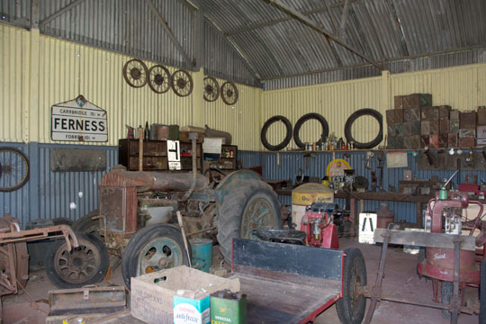 Inside the garage at the croft, with an old tractor, an old road sign to Ferness and lots of tools