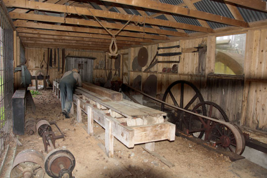 A reconstructed mill workshop complete with a mannequin of a workman