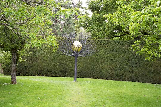 Tree with a golden globe - architectural work