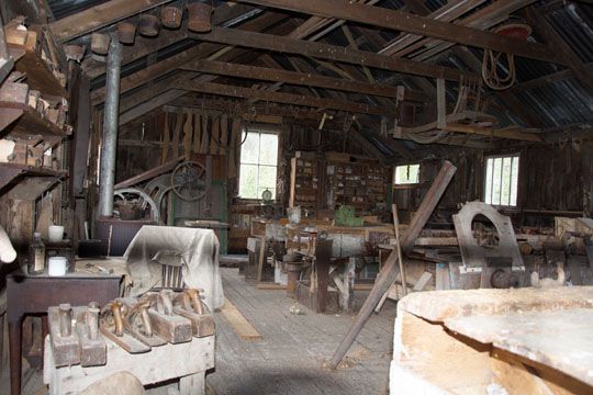inside a woodworkers shed with benches and tools